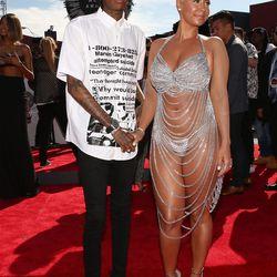 Amber Rose keeps the naked-celebs-at-awards dream alive with Wiz Khalifa.
