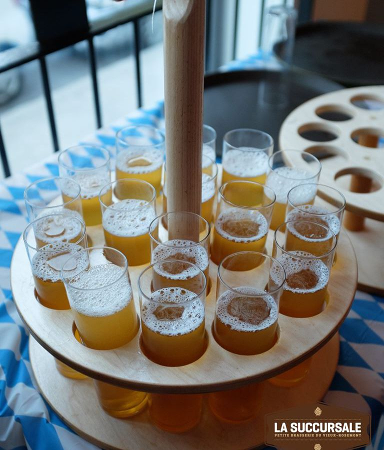 A tasting tray full of beer.
