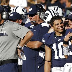 With Brigham Young Cougars head coach Bronco Mendenhall at left, Brigham Young Cougars running back JJ Di Luigi and Brigham Young Cougars quarterback Riley Nelson smile during the fourth quarter as Brigham Young University faces Idaho State in NCAA football in Provo, Saturday, Oct. 22, 2011.