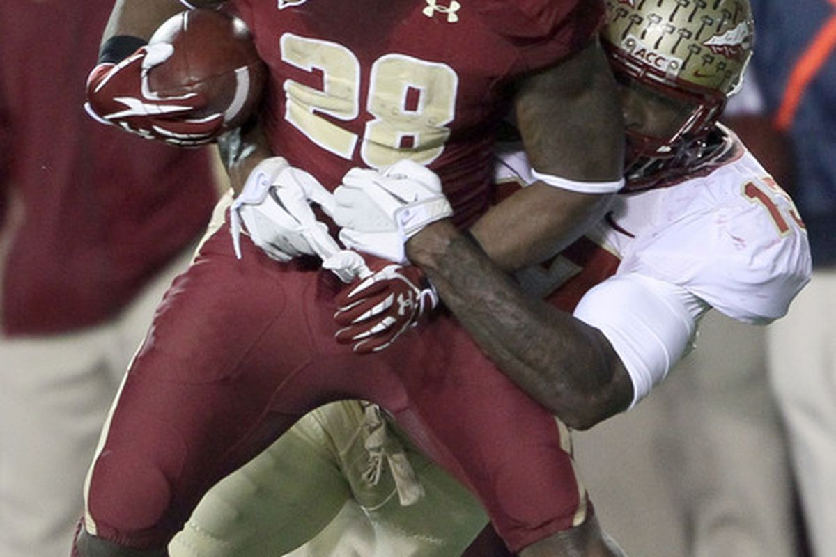 CHESTNUT HILL, MA - NOVEMBER 03:  Rolandan Finch #28 of the Boston College Eagles is tackled by Nigel Bradham #13 of the Florida State Seminoles on November 3, 2011 at Alumni Stadium in Chestnut Hill, Massachusetts.  (Photo by Elsa/Getty Images)