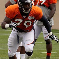 Denver Broncos rookie John Youboty moves for the ball