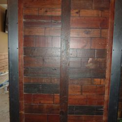 sliding door features 250 year old reclaimed wood from the building. The same wood is used on many of the tables, the entire bar, walls and other details throughout.