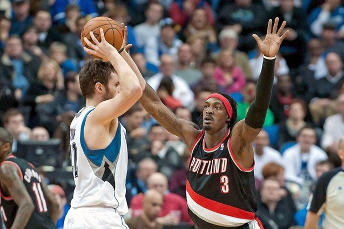 Mar 7, 2012; Minneapolis, MN, USA; Portland Trail Blazers small forward Gerald Wallace (3) defends against Minnesota Timberwolves power forward Kevin Love (42) during the second quarter at Target Center. Mandatory Credit: Greg Smith-US PRESSWIRE