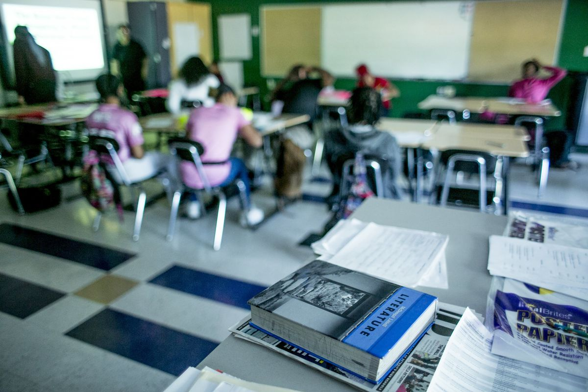 Students learning in a classroom at desks in Detroit