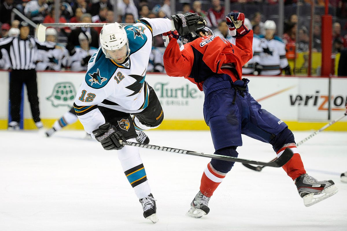 WASHINGTON, DC - FEBRUARY 13:  Patrick Marleau #12 of the San Jose Sharks collides with Marcus Johansson #90 of the Washington Capitals at the Verizon Center on February 13, 2012 in Washington, DC.  (Photo by Greg Fiume/Getty Images)