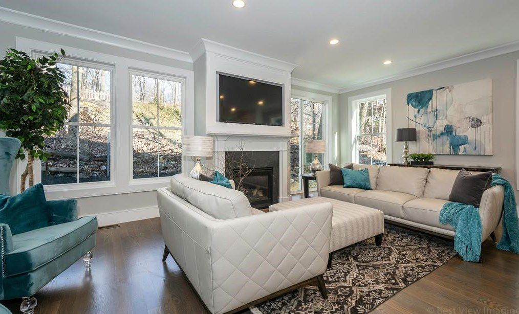 Living-room area with fireplace and built in tv surround.