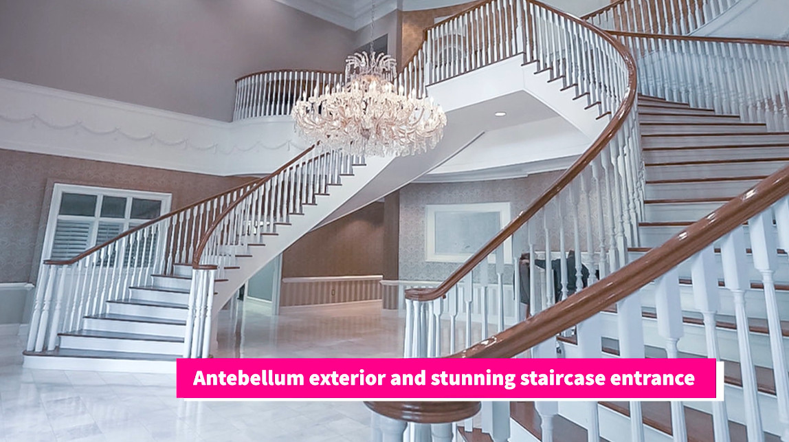 A huge foyer with two staircases in a mansion.