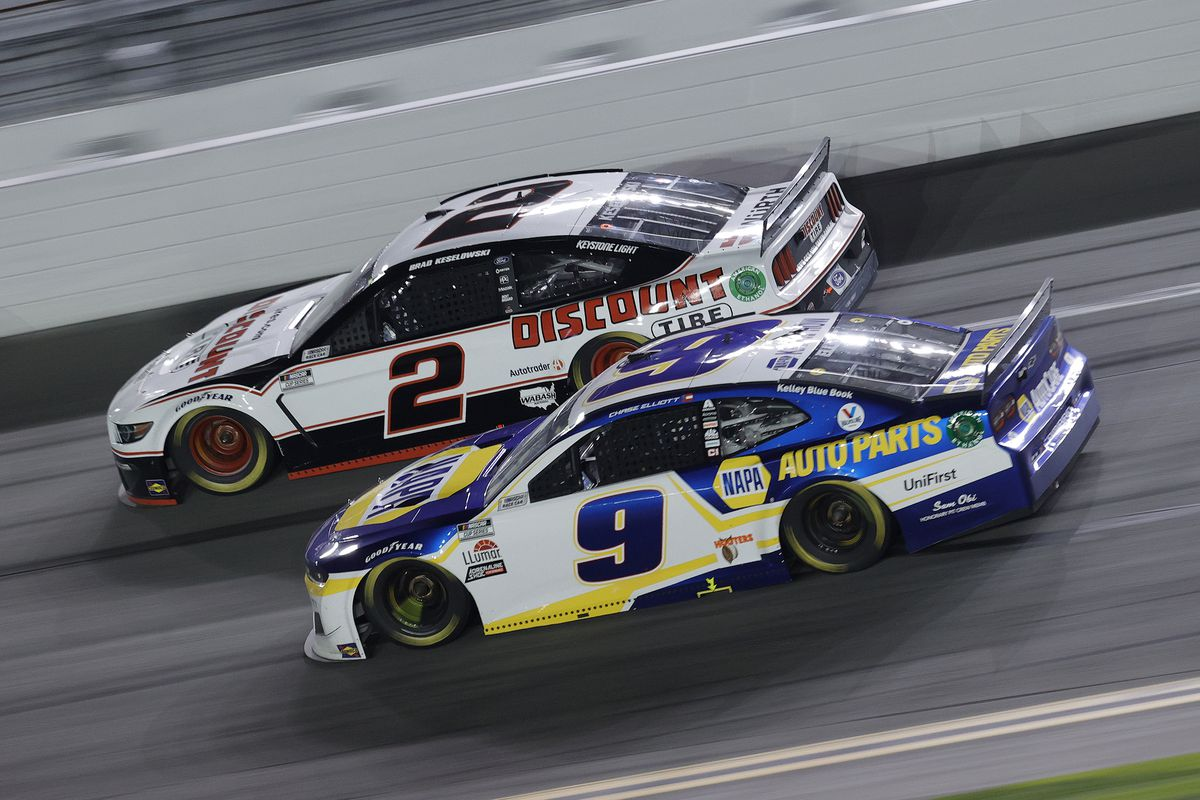 Chase Elliott, driver of the #9 NAPA Auto Parts Chevrolet, and Brad Keselowski, driver of the #2 Discount Tire Ford, race during the NASCAR Cup Series 63rd Annual Daytona 500 at Daytona International Speedway on February 14, 2021 in Daytona Beach, Florida.