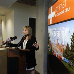 Laura Nelson, the governor's energy adviser and executive director of the Office of Energy Development, speaks as her office, in partnership with Utah Clean Air Partnership and Maverik Inc., launch the Mighty Five Electric Vehicle Corridor Initiative in Salt Lake City on Tuesday, Aug. 1, 2017, with the installation of two DC fast chargers.