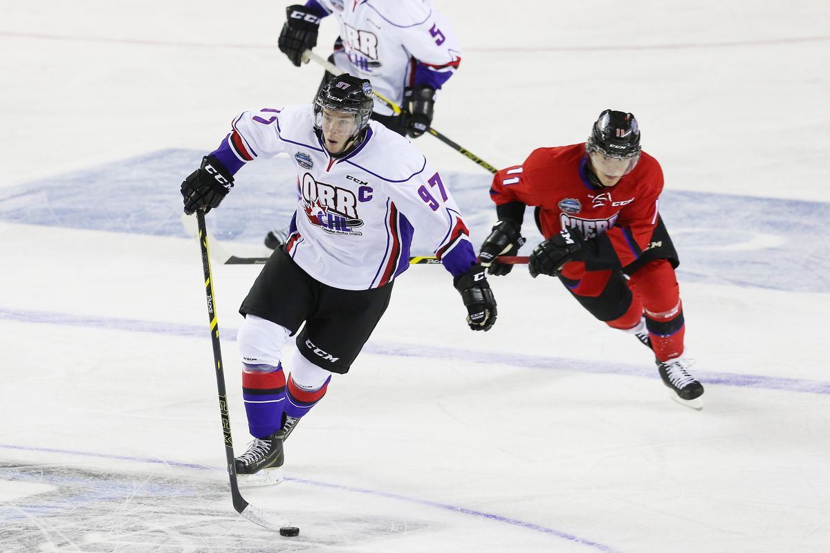 Connor McDavid #97 of Team Orr is chased by Daniel Sprong #11 of Team Cherry during the 2015 BMO CHL/NHL Top Prospects Game at the Meridian Centre on January 22, 2015 in St Catharines, Ontario, Canada