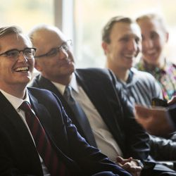 Conner Nelson, Assistant Dean of the Marriott School Mike Roberts, Brett Huish and Doug Hintze laugh as CEO of the Philadelphia 76ers Scott O'Neil speaks to students of the BYU Marriott School in Provo, Thursday, Oct. 13, 2016.