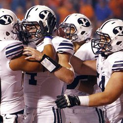 Taysom Hill, second from left, of the Brigham Young Cougars celebrates scoring BYU's only touchdown during NCAA football in Boise, Thursday, Sept. 20, 2012.