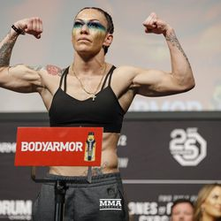 Cris Cyborg poses at UFC 232 weigh-ins.