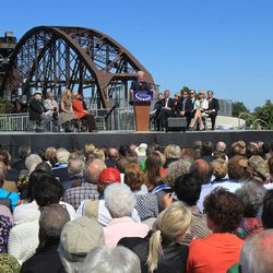 A crowd fills seats at the foot of the Clinton Presidential Park Bridge as former President Bill Clinton speaks during the dedication ceremony, Friday, Sept. 30, 2011, in Little Rock, Ark.