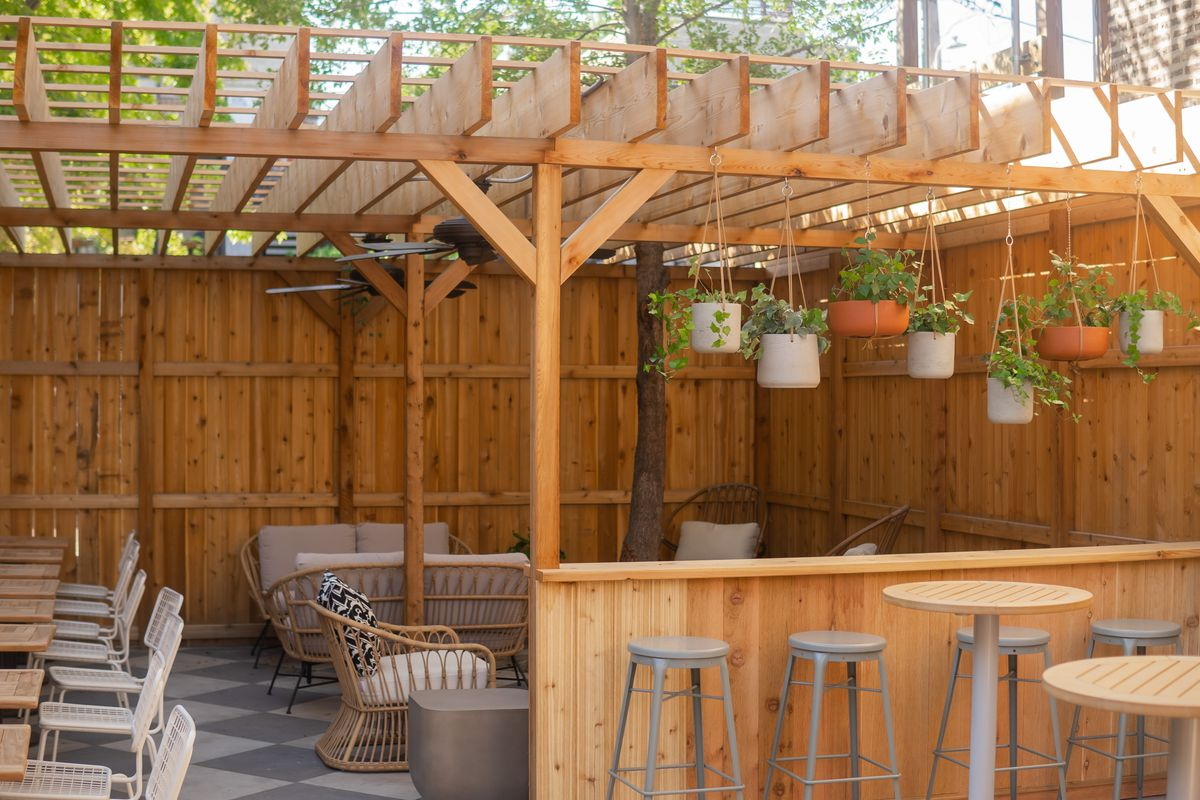 A patio space with a wooden overhang.