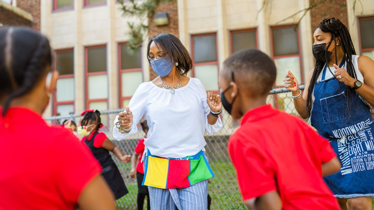 Educators and students celebrate the first day of school at Paul Robeson Malcom X Academy.