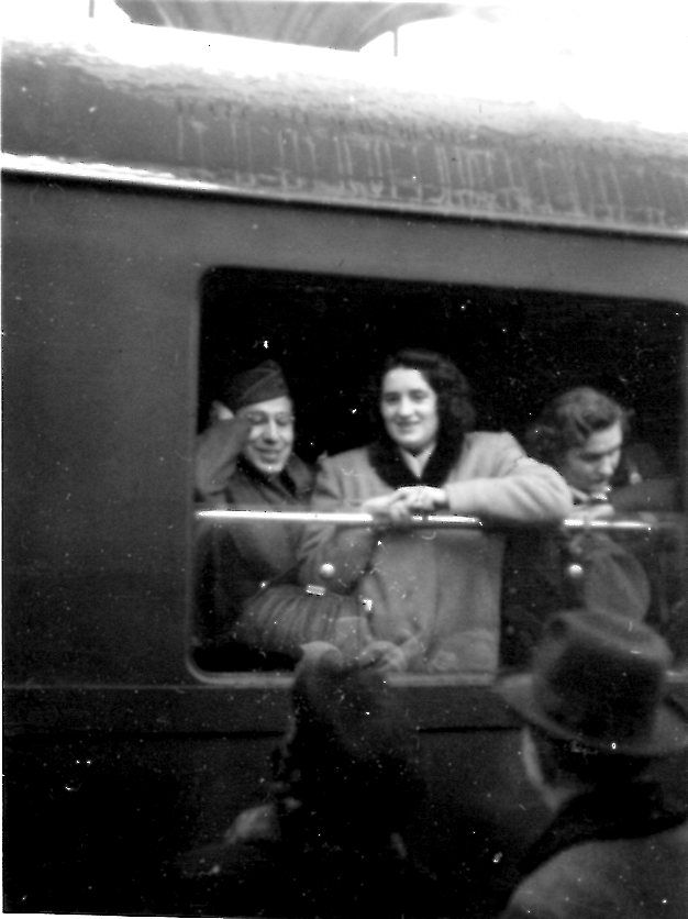 A man and woman on a train.