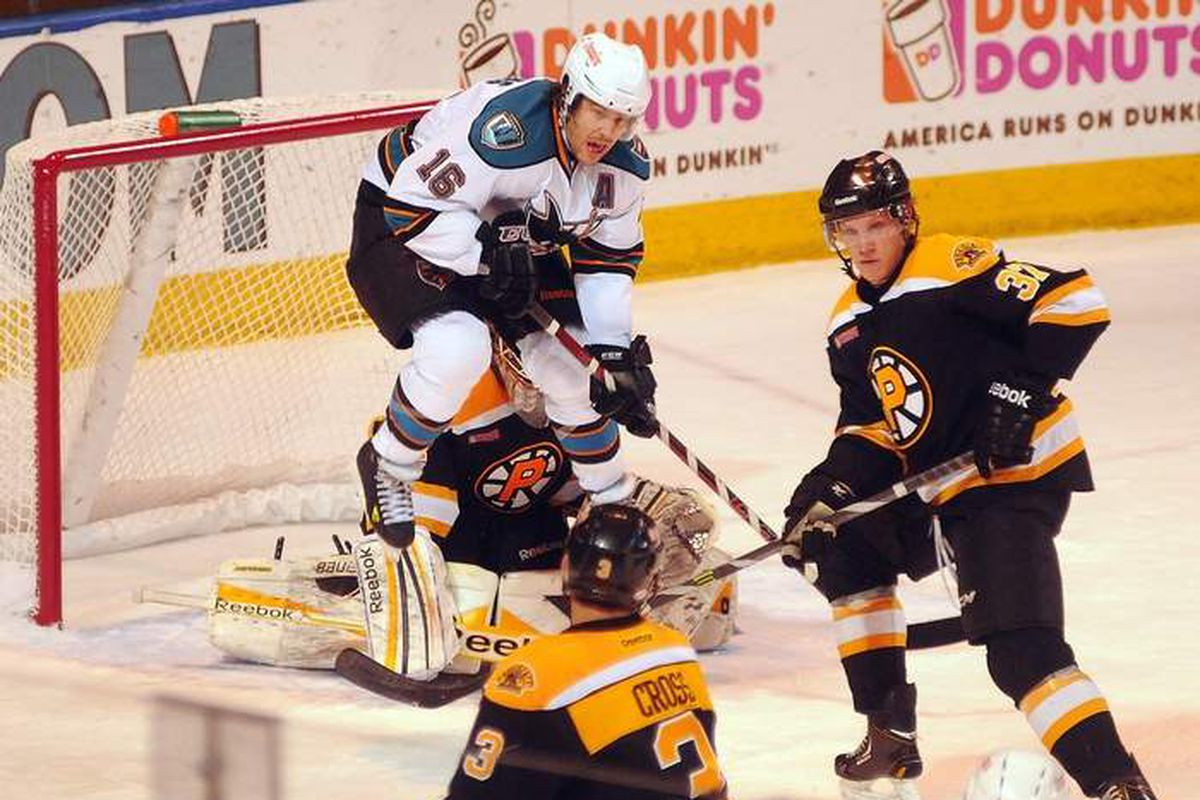 Worcester Sharks forward (and alternate captain) Bracken Kearns attempts to block the vision of Providence Bruins goaltender Niklas Svedberg during Thursday night's game at the DCU Center.