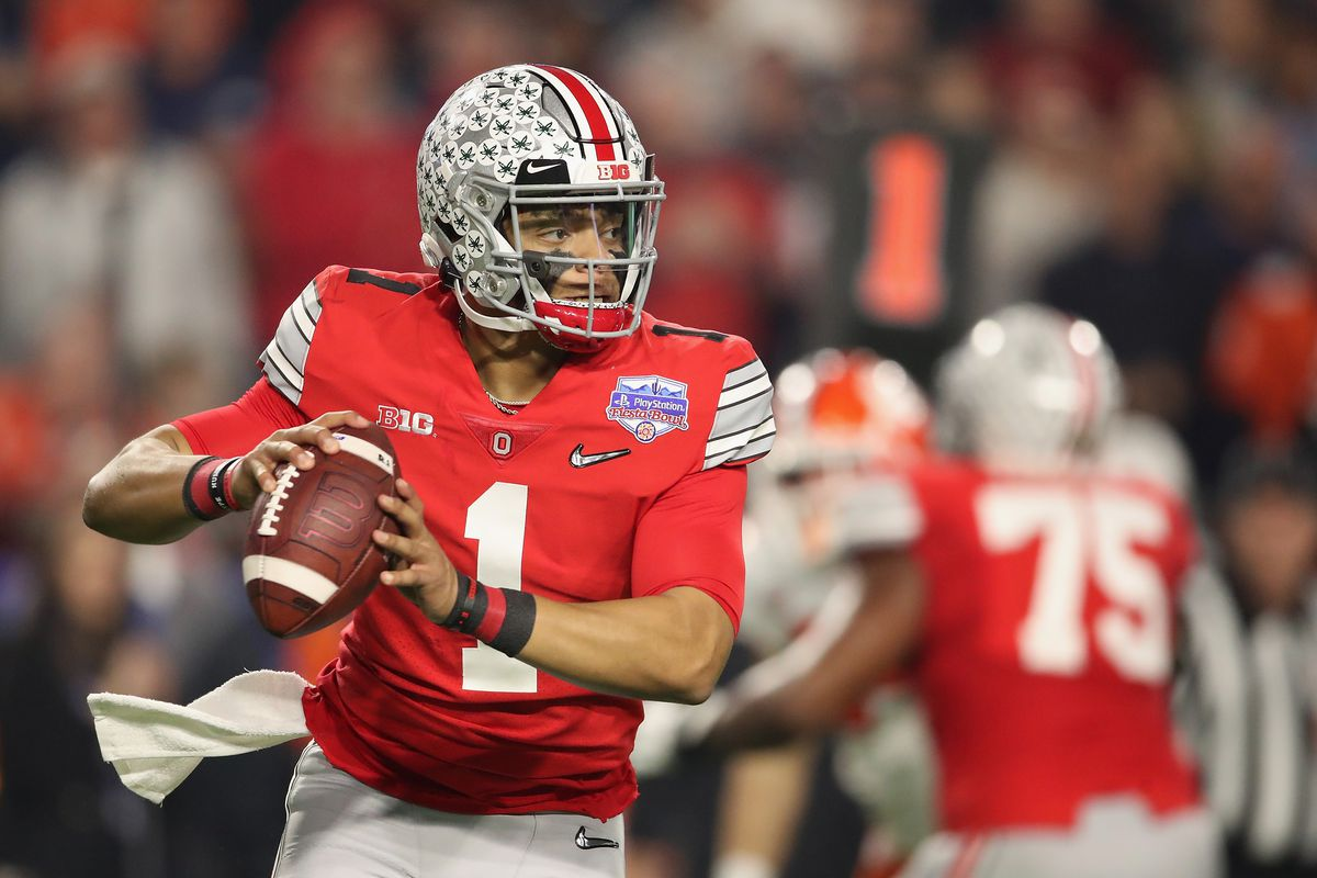 Quarterback Justin Fields of the Ohio State Buckeyes drop back to pass during the PlayStation Fiesta Bowl against the Clemson Tigers at State Farm Stadium on December 28, 2019 in Glendale, Arizona. The Tigers defeated the Buckeyes 29-23.