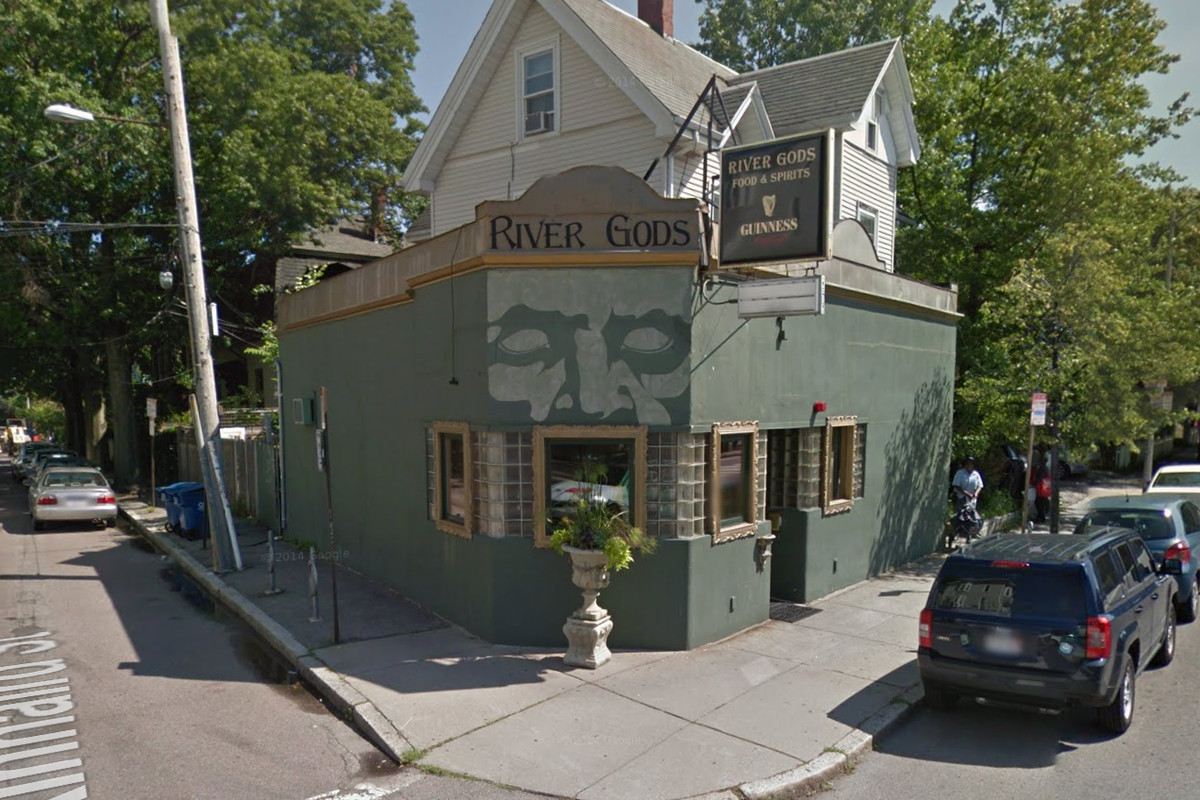 A green corner building on Rover Street in Cambridge, MA.