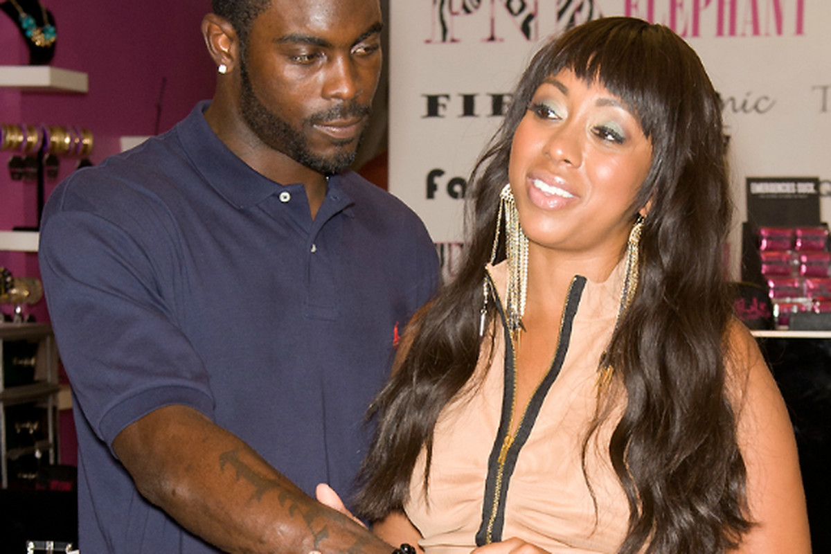 Michael Vick And New His Wife Kijafa Frink In Their Jewelry Store On South Stree