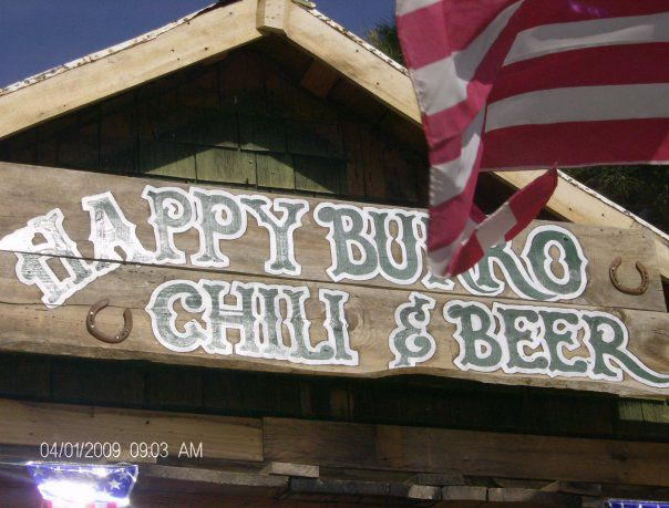 Sign outside of building reading Happy Burro Chili and Beer