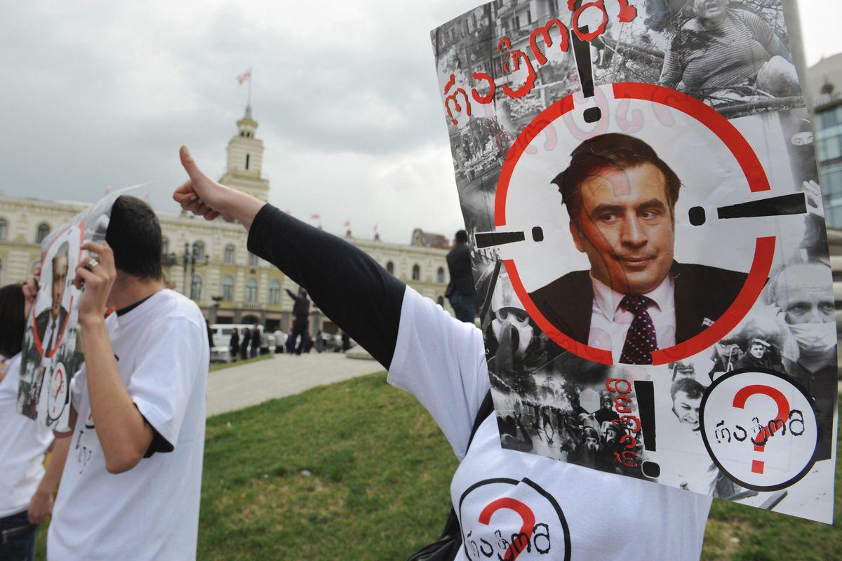 A protestor holds an image of Mikheil Saakashvili in Tbilisi, Georgia.