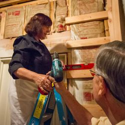 Carol and Ed Diener build a shelf in their basement in Salt Lake City, Utah, on Monday, Aug. 28, 2017. Ed, a research psychologist, and Carol, a clinical psychologist, have applied principles of happiness and well-being to their family life and their lives together.