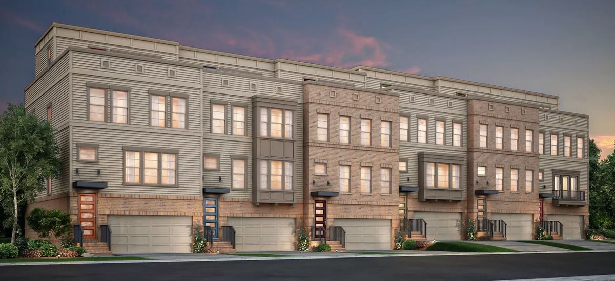 A row of bland, boxy townhomes.