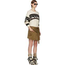 "<b>Isabel Marant</b> skirt, <a href=""https://www.ssense.com/women/product/isabel_marant/green-wrap-jaci-skirt/114290"">$195</a>"
