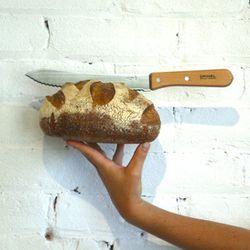 """Opinel bread knife, <a href=""""http://gravelandgold.com/shop/home-dome/opinel-bread-knife/"""">$40</a> at Gravel & Gold; a man needs a good knife"""