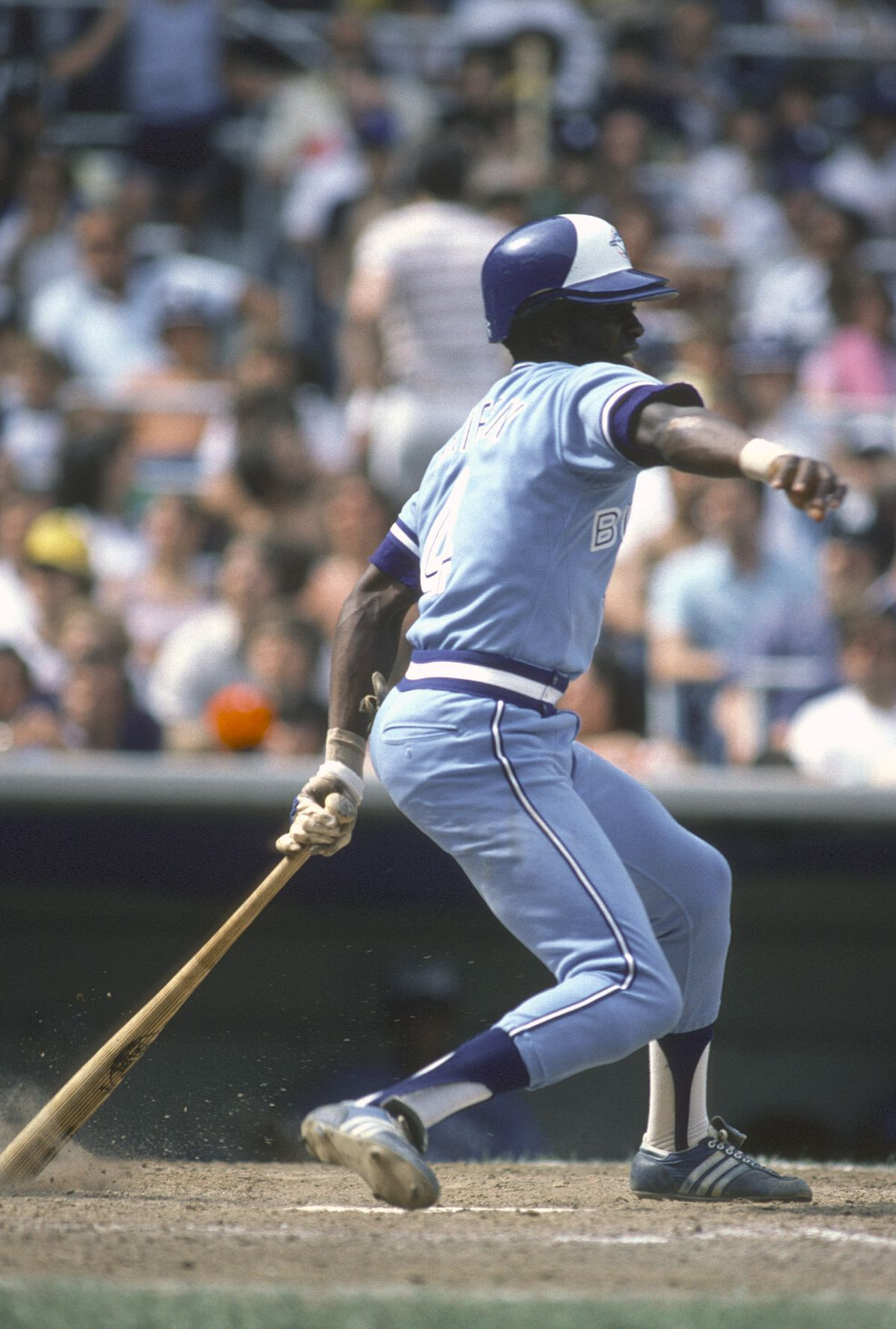 Alfredo Griffin (#4) takes a swing at Yankee Stadium.