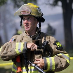 Unified fire public information officer Patrick Costin talks to members of the media at the scene of a house fire in Millcreek on Thursday, July 9, 2020. The fire is the third structure fire on this block in a week, and the second fire at the house behind him. Four houses in total have been damaged in the week's fires.