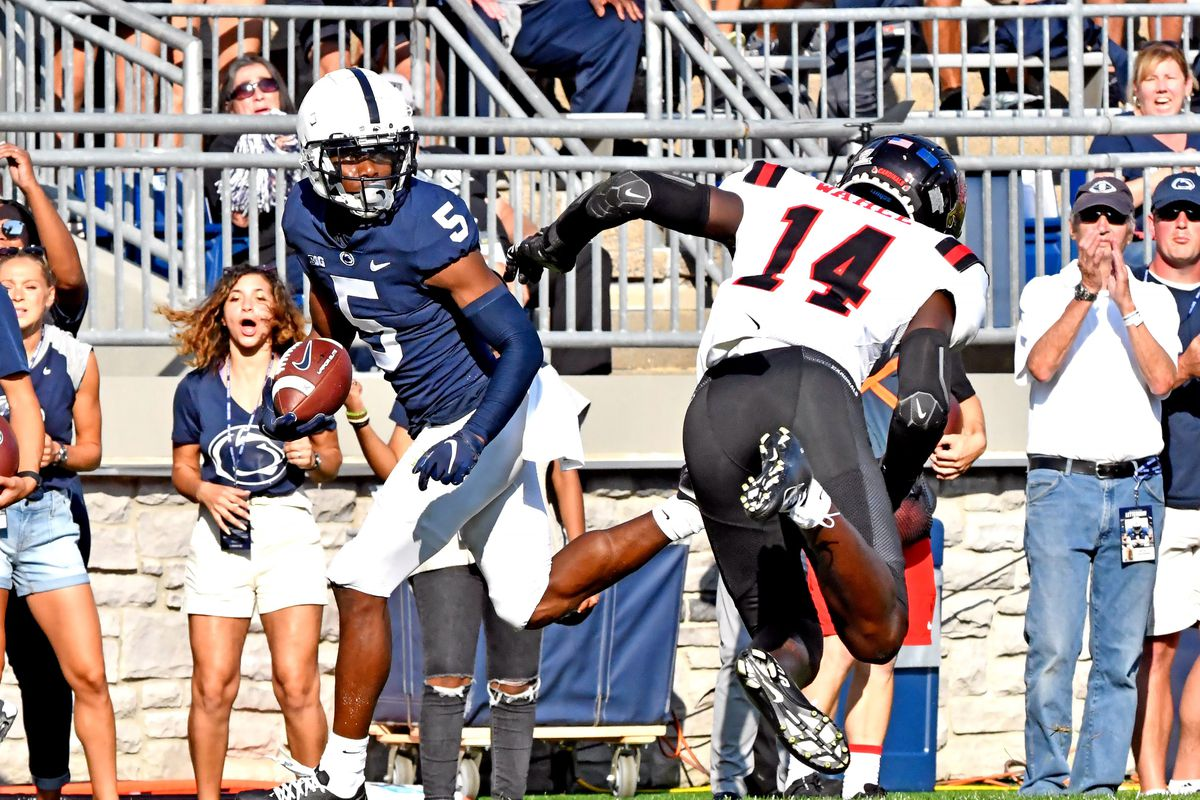 Penn State wide receiver Jahan Dotson runs past defensive backs in a game against Ball State.
