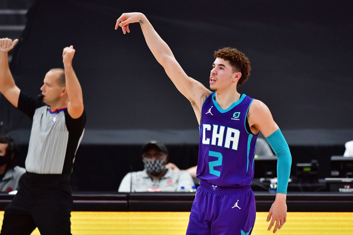 LaMelo Ball of the Charlotte Hornets looks on after scoring a three-point basket during the second half against the Toronto Raptors at Amalie Arena on January 14, 2021 in Tampa, Florida.