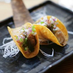 """Smoked black cod tacos from Nobu Next Door by <a href=""""http://www.flickr.com/photos/amlamster/5964208782/in/pool-eater/"""">amlamster</a>."""