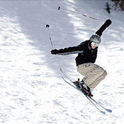 A Brighton skier catches big air in the freestyle terrain park in February. The resort has purchased two new Snowcats over the summer to prepare for the 2005-06 season.
