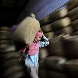 In this photo taken Tuesday, April 17, 2012, an Indian worker carries a sack of tea at a tea factory in Amritsar, India. Decades of conflict have decimated trade between the two nuclear armed South Asian neighbors. Now, with peace efforts between the rivals stalled, officials are hoping that trade could lead the way to easing tensions. They have liberalized their commercial ties, inaugurated a new border depot and promised to throw open their economies to each other by the end of the year.