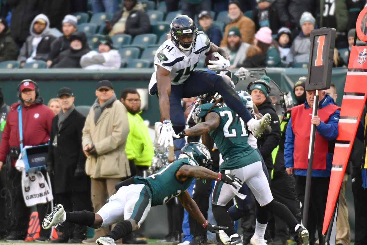 Seattle Seahawks wide receiver D.K. Metcalf leaps over Philadelphia Eagles cornerback Jalen Mills during the fourth quarter at Lincoln Financial Field