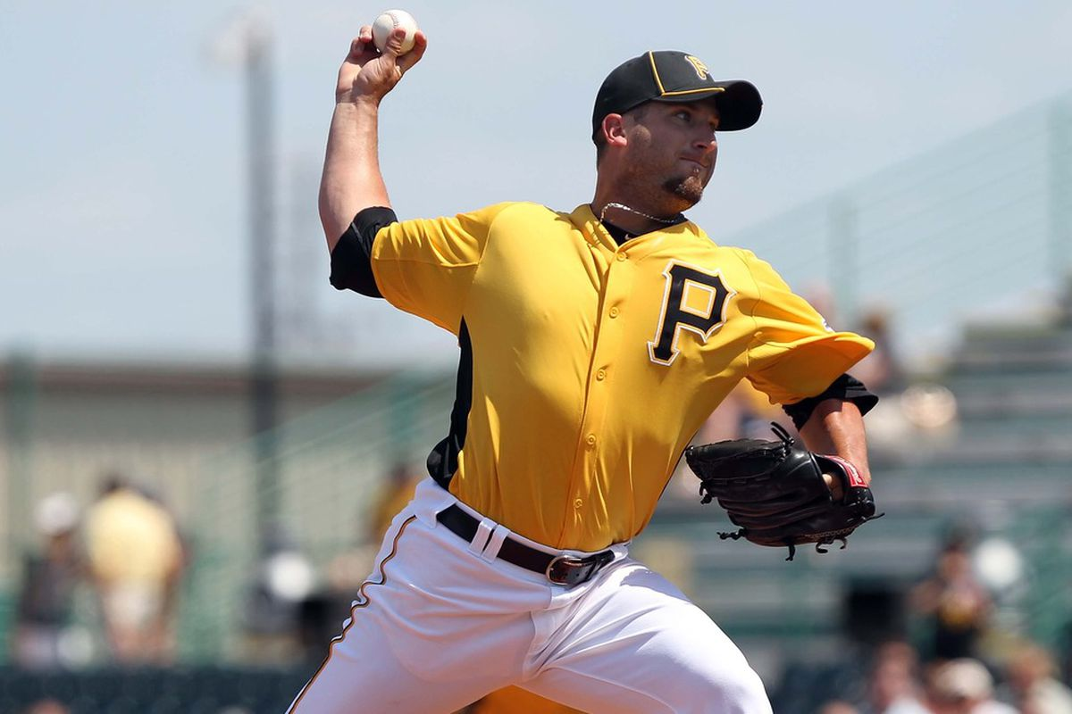 March 30, 2012; Bradenton, FL, USA; Pittsburgh Pirates relief pitcher Brad Lincoln (32) throws a pitch in the sixth inning against the Tampa Bay Rays at McKechnie Field.  Mandatory Credit: Kim Klement-US PRESSWIRE