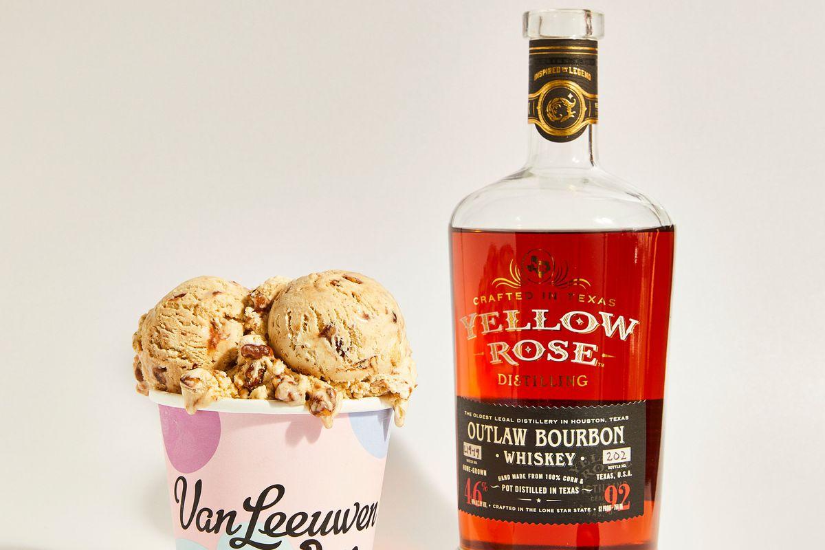 a pint of van leeuwen ice cream next to a bottle of yellow rose texas bourbon