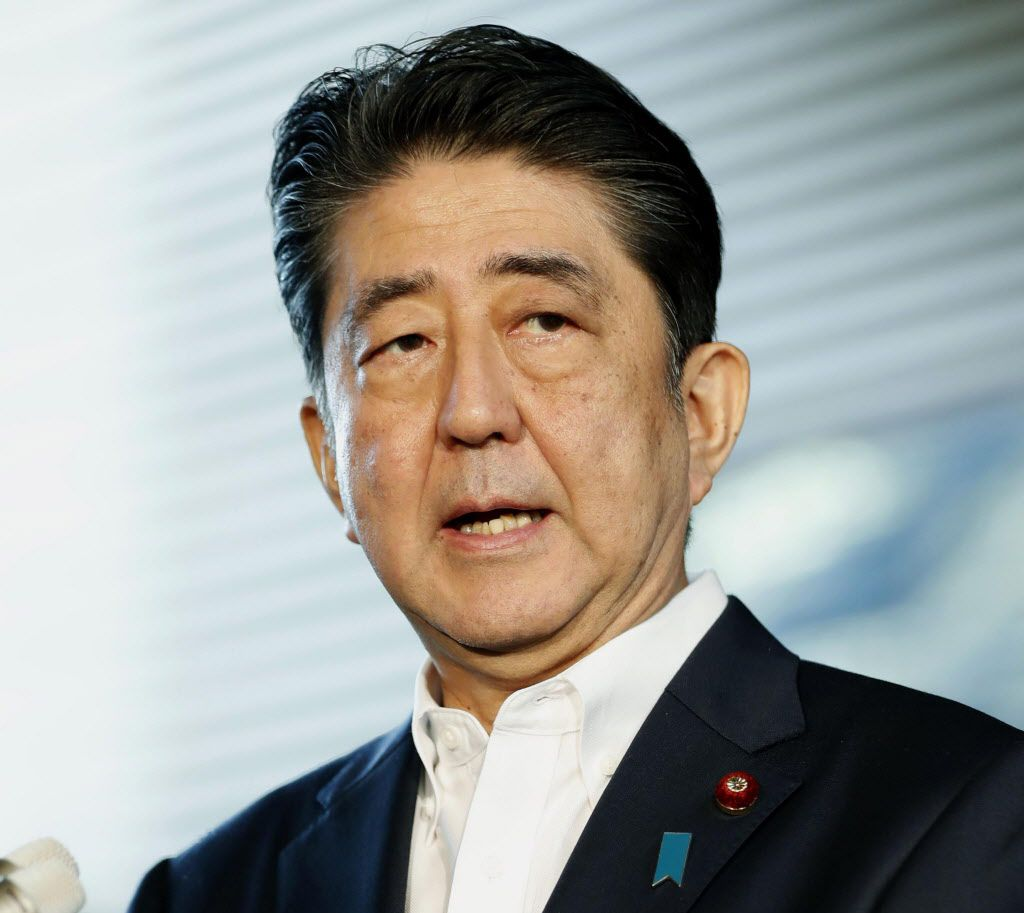 Japanese Prime Minister Shinzo Abe speaks to journalists at his official residence in Tokyo after North Korea's firing of a projectile over Japan on Tuesday.   Kyodo News via AP
