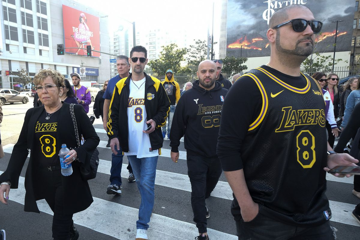 Fans walk to the Staples Center to attend a public memorial for former Los Angeles Lakers star Kobe Bryant and his daughter, Gianna, in Los Angeles, Monday, Feb. 24, 2020.
