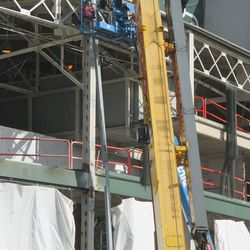 12:04 p.m. The beam is being attached to front of the existing support beam -