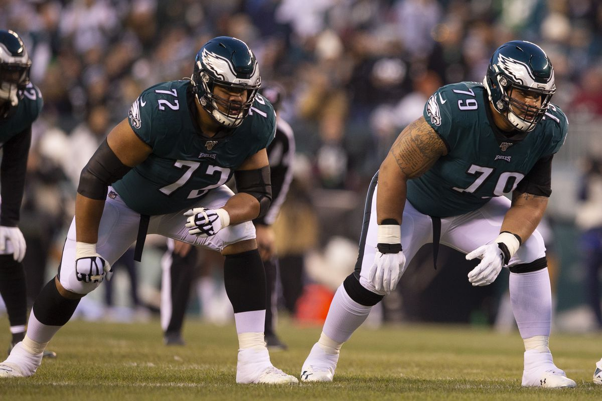 Halapoulivaati Vaitai and Brandon Brooks of the Philadelphia Eagles in action against the Dallas Cowboys at Lincoln Financial Field on December 22, 2019 in Philadelphia, Pennsylvania.