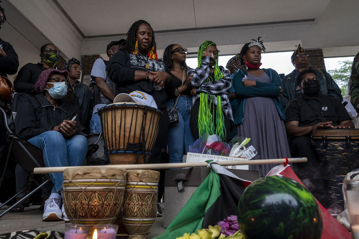 A memorial and candlelight vigil for Keith Cooper was held the night of Friday, July 16, 2021 at Kimbark Plaza, where Cooper collapsed after an attempted carjacking. Two teens are now charged with his murder. Among those at the vigil were (from left) Cooper's ex-wife, Sonja Cooper; daughter Keinika Carlton; daughter-in-law Crystal Carlton; and granddaughters Alyna Carlton, 17 and Mikayla Carlton, 11.