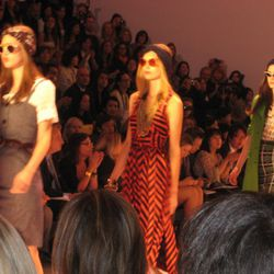 Milly's models in Peggy Guggenheim-inspired clothing and sunglasses