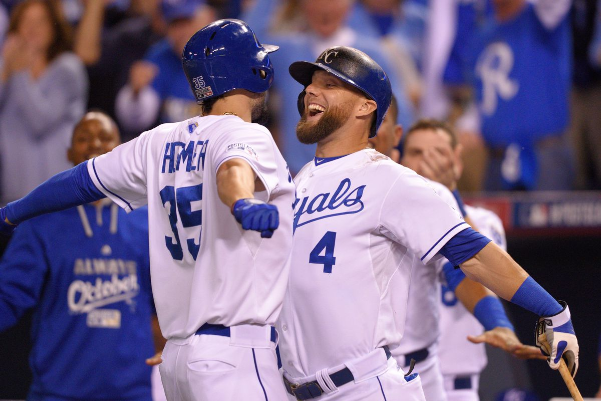 Eric Hosmer #35 and Alex Gordon #4 of the Kansas City Royals celebrate during game 3 of the American League Division Series against the Los Angeles Angels of Anaheim on October 5, 2014 at Kauffman Stadium in Kansas City, Missouri.