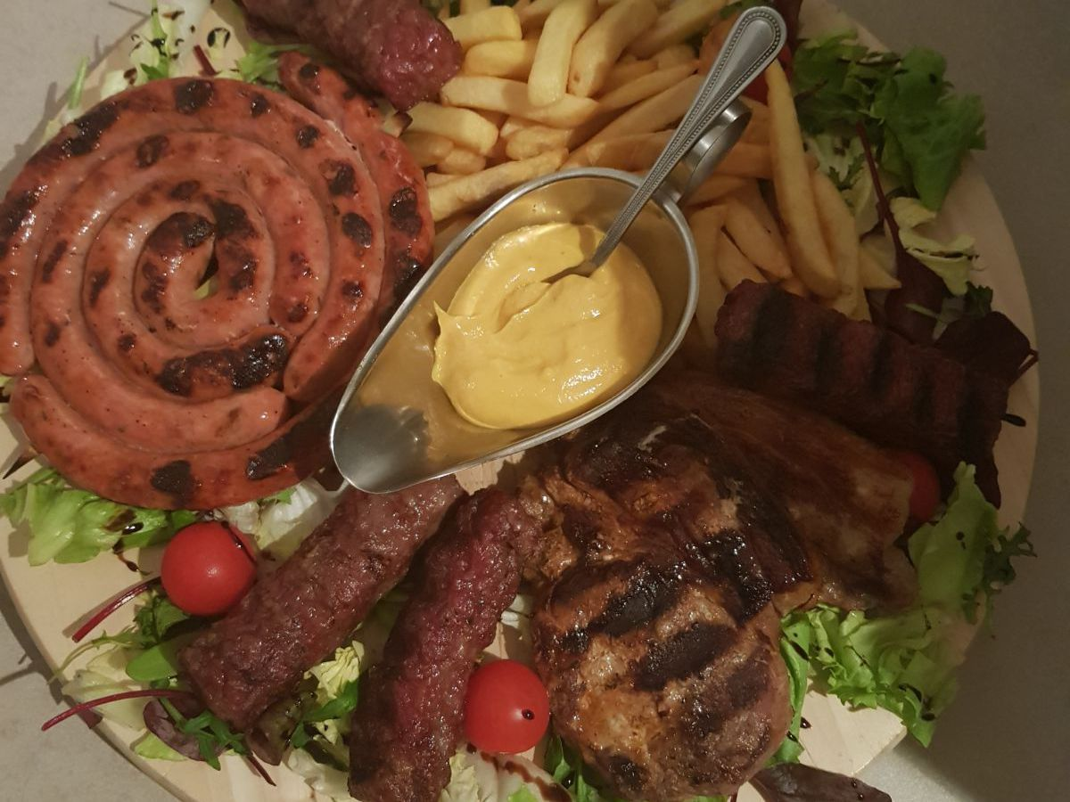 Sausages, salad, and mayonnaise at Zazara restaurant in Forest Gate, E7