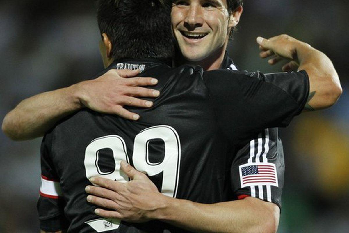 "Chris Pontius and Jaime Moreno celebrate after each scored first half goals, via <a href=""http://cache.daylife.com/imageserve/01Qz4XQ2xVc08/x610.jpg"">daylife.com</a>"